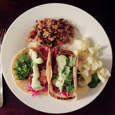 Cinnamon Spice Fish Tacos:  White fish fillet coated with a spicy cayenne cinnamon spice mix, wrapped in a corn tortilla and topped with cool cabbage and creamy avocado sauce.