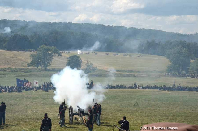 Gettysburg, reenactment of battle of 1863, cannon being fired.