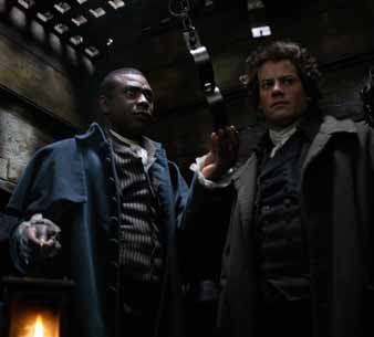 Ioan Gruffud and Youssou N'Dour in a scene from Amazing Grace.