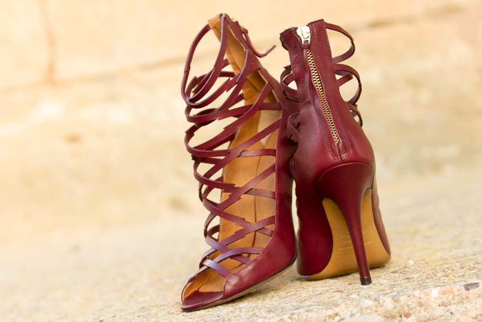 Interwoven Front Straps Isabel Marant's burgundy leather Paw sandals cut with a jagged finish