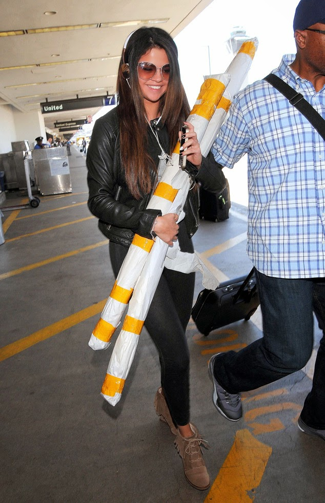 SELENA GOMEZ The actress and pop star totes some tubes at ...