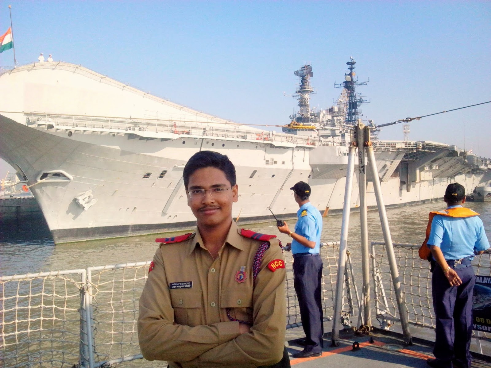 SUO Akshay Lohote On Indian Naval Ship 'INS Mysore' and In Background Aircraft Carrier 'INS Viraat'