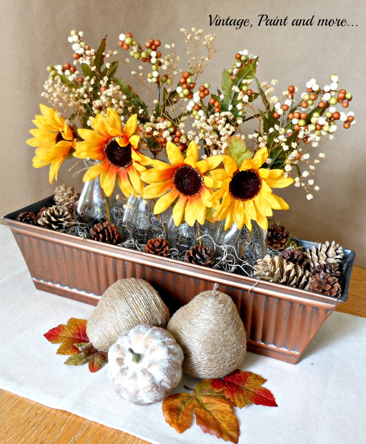 Vintage, Paint and more... sunflower centerpiece in a vintage bronze trough with twine wrapped pears