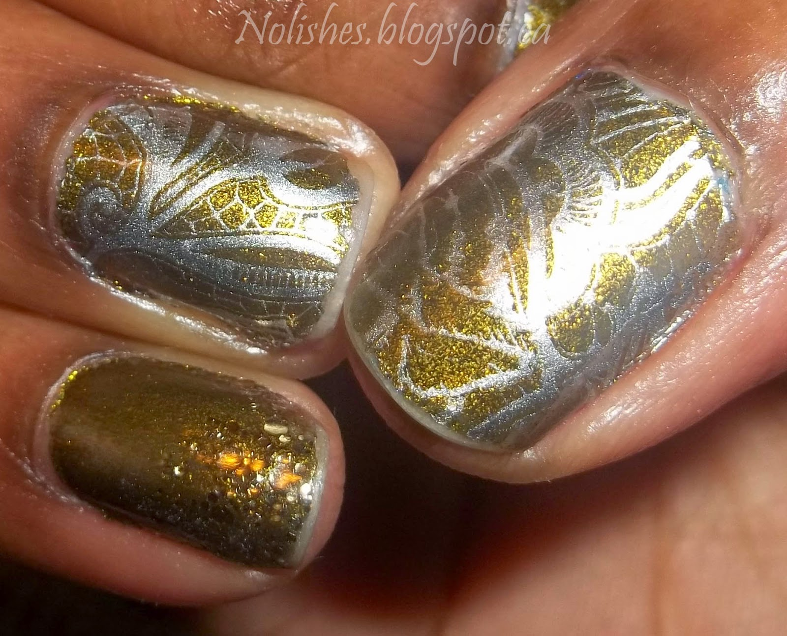 Nail stamping manicure using Butter London's 'Wallis' as a base, with thumb and ring accents stamped with silver, and a gold glitter gradient on the remaining fingers.