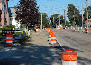 sidewalk work along West Central in front of the Historical Museum