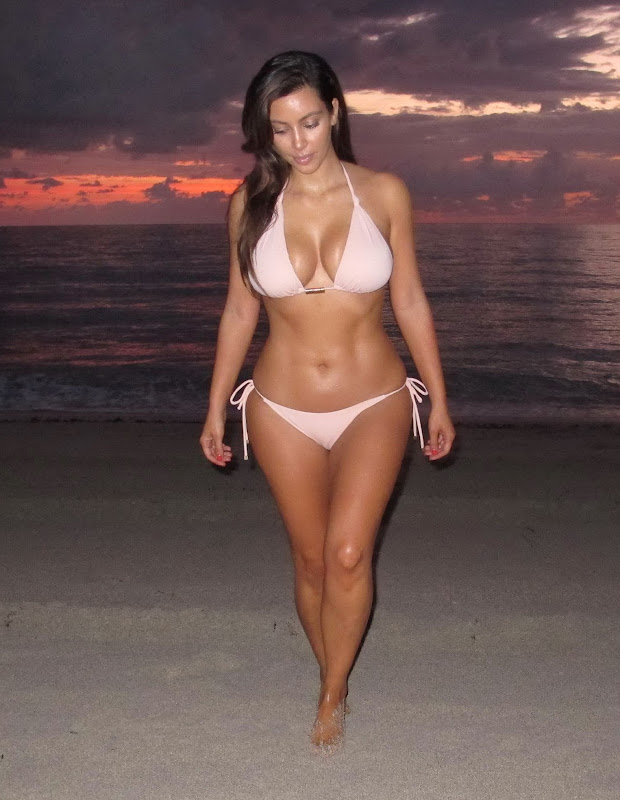 Kim Kardashian shows off her curves in a skimpy bikini