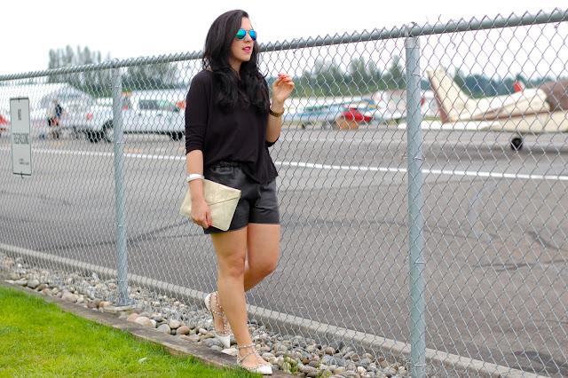 Valentino Rockstud flats, Topshop leather shorts and shirt and flash frame aviators.