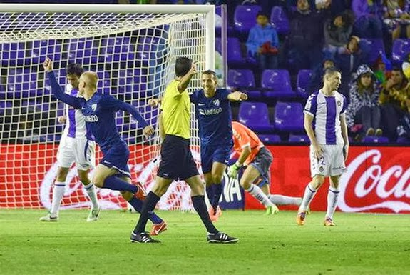 Málaga player Bartłomiej Pawłowski celebrates after scoring the equaliser against Valladolid