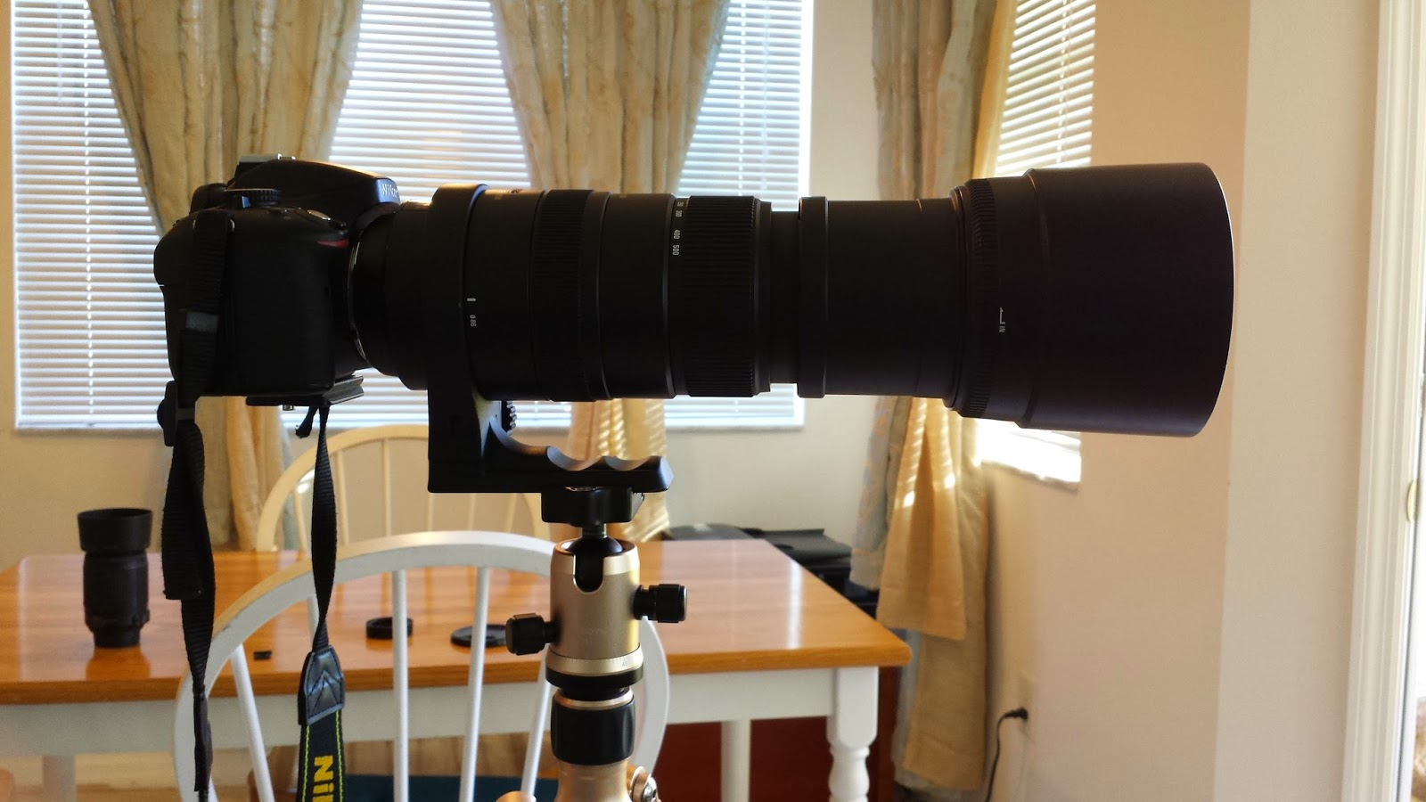 image of nikon camera with sigma 150-500mm lens attached