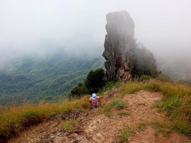 traveladik climbing Monolith!