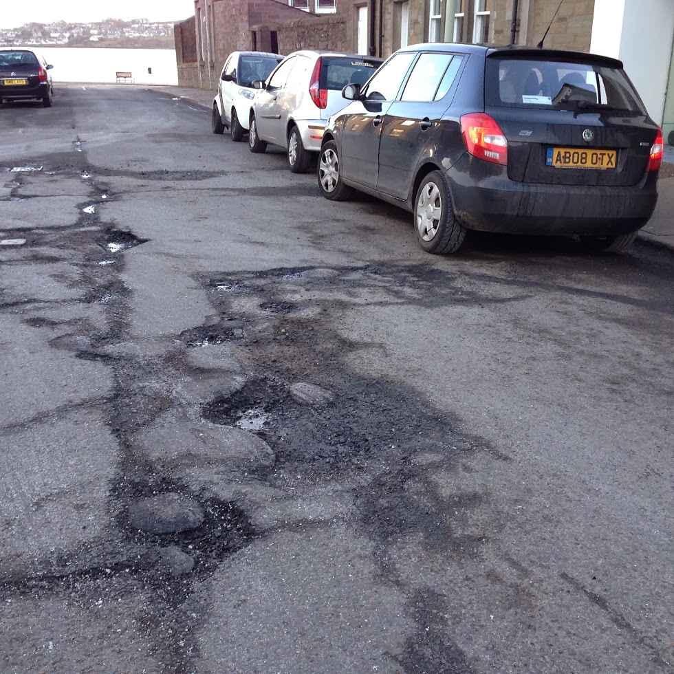 Potholes close to the junction of Westfield Road and King Street in Broughty Ferry, February 2014