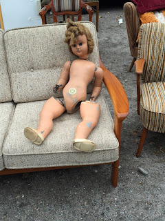 creepy doll with unattached legs at a Hamburg flea market