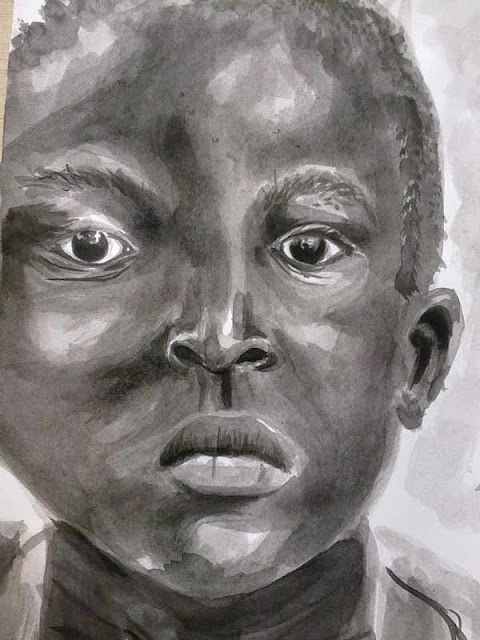 rostro infantil dibujado en tinta china