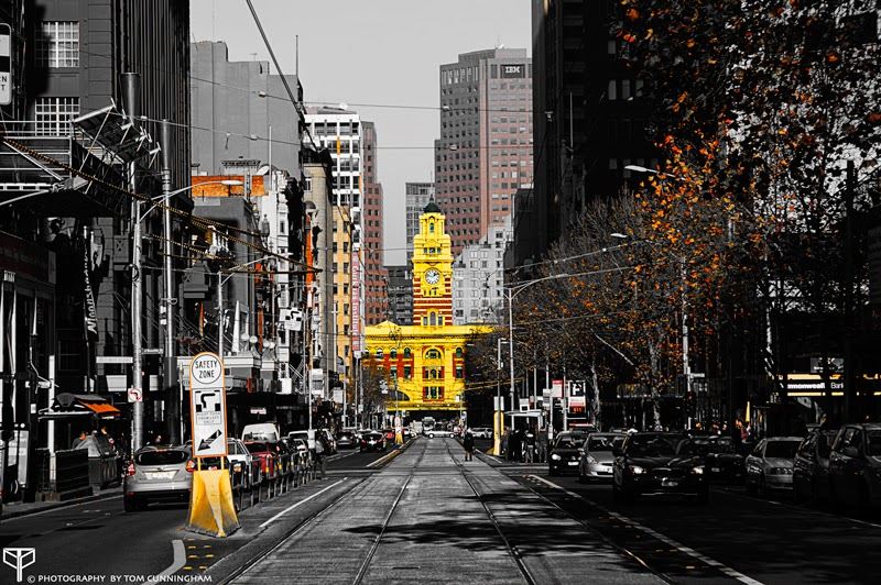 A selective colour photograph by Tom Cuynningham shooting down Elizabeth St of Flinders Street Station in Melbourne