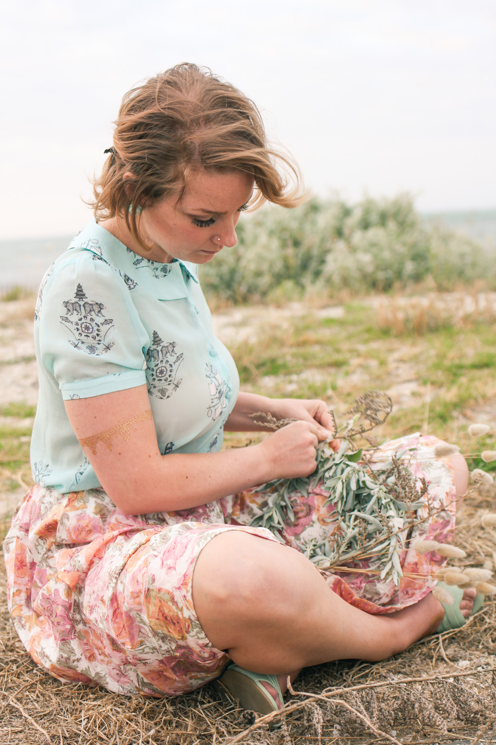 Liana of Finding Femme wears a seaside flower crown with Book of Deer blouse and Lazybones skirt.