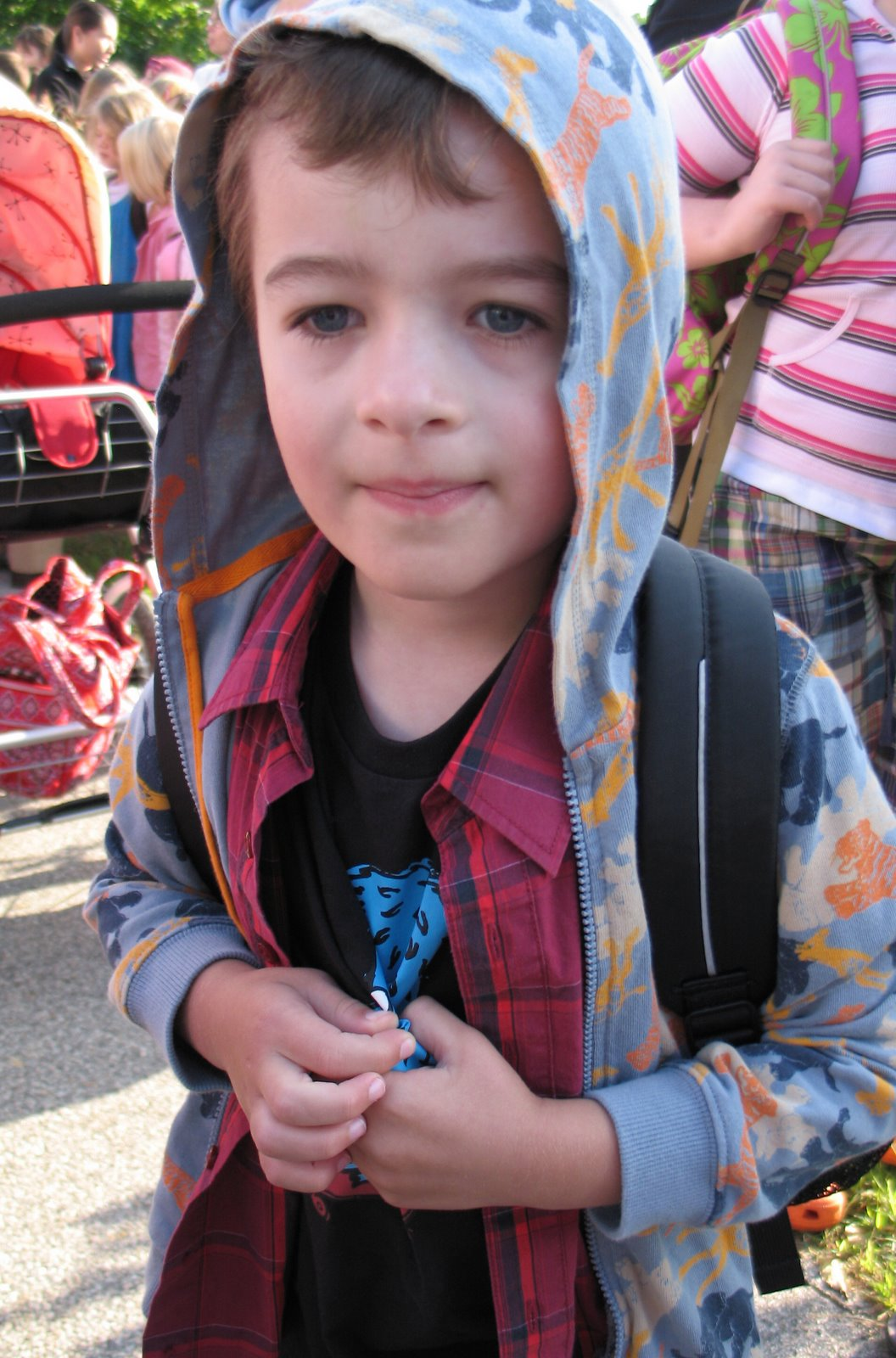 small boy wearing hoodie