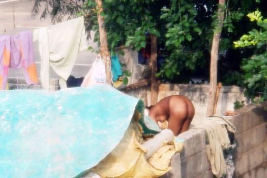 Worker lady taking Nude bath voyeur pics