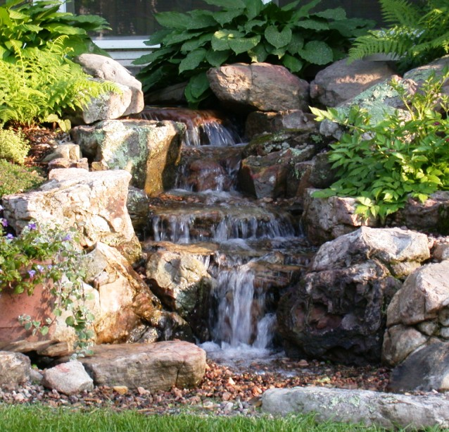 Water feature on pinterest water features backyard for Garden waterfall design