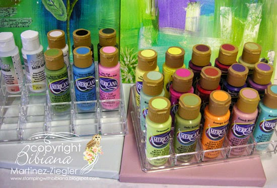two acrylic stadium organizers for paint bottles