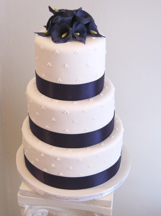Next comes another purple cake wrapped with purple ribbons and topped with