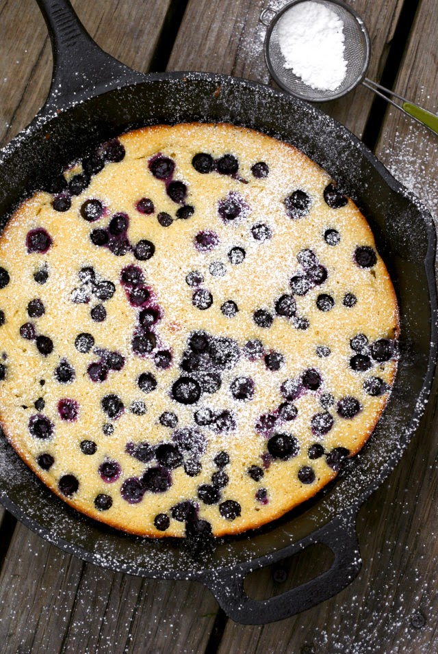 This Oven-Baked Blueberry Pancake made from scratch is full of fresh blueberries and has a dusting of sweet powdered sugar.