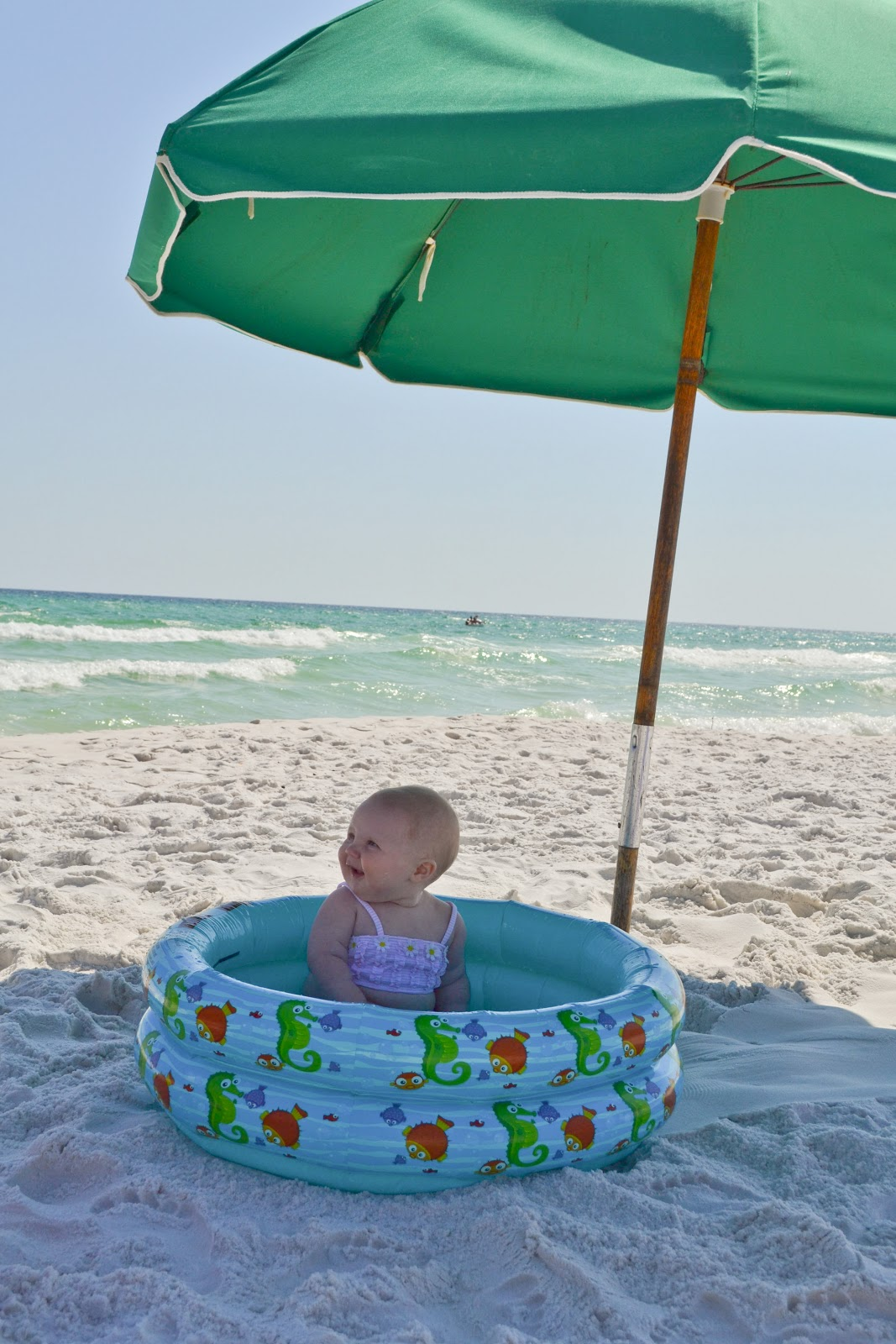 Little and lovely taking baby to the beach and enjoying it 3 month old baby swimming pool