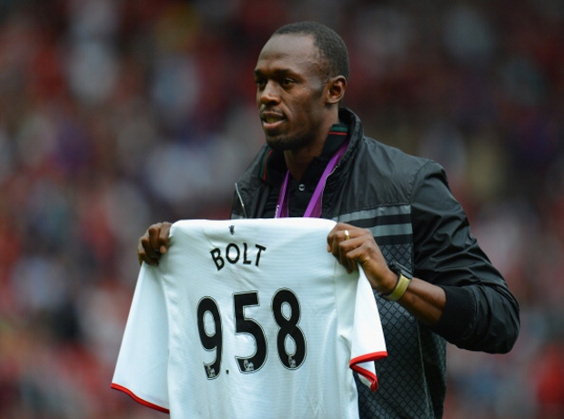 USAIN BOLT WITH MANCHESTER UNITED JERSEY