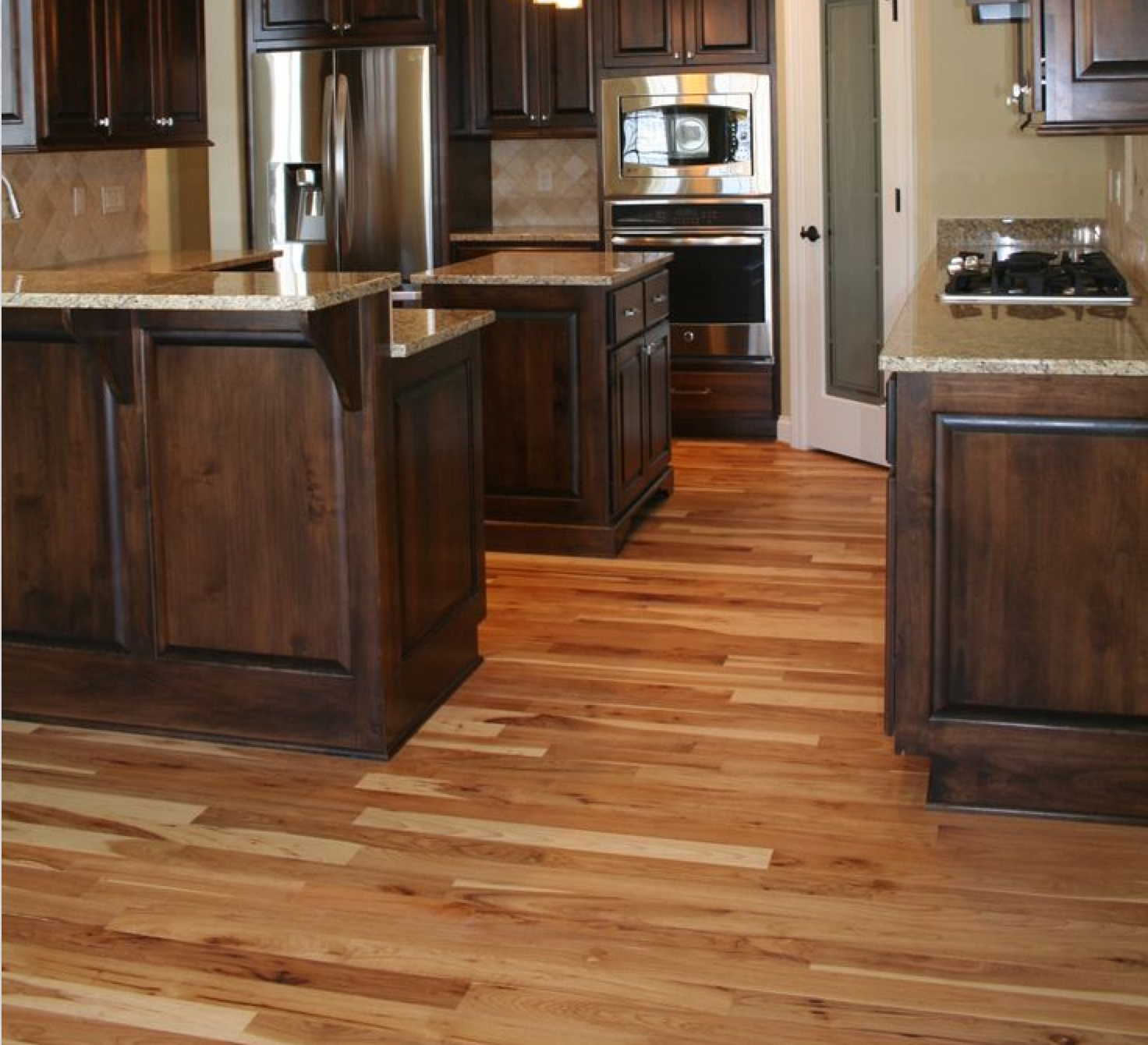 Dark cabinets with hickory wood floors wood floors for Floor kitchen cabinets