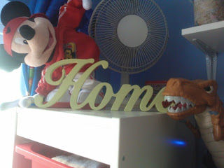Home sign in Big Boy's room
