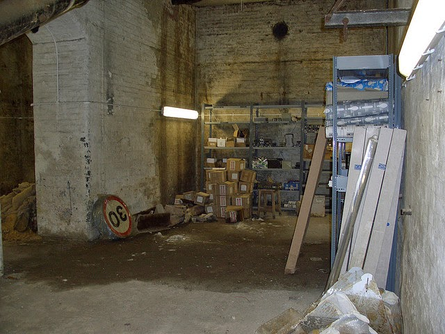 Main mortuary chamber looking to the left of the archway. Photo is taken  near the underside of the Tower Bridge stairs - the pile of sacks in the  antechamber is visible along the left side of the photograph.  (From Flickr - Martin Belam - used under Creative Commons.)