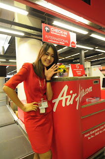 Thai AirAsia Stewardess Flight Counter Attendant. Cute. Wave hello.