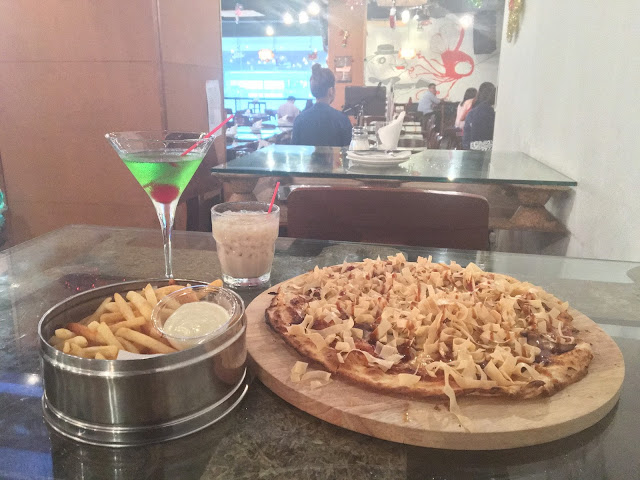 switch by timbre roasted duck pizza truffle fries apple martini mudslide