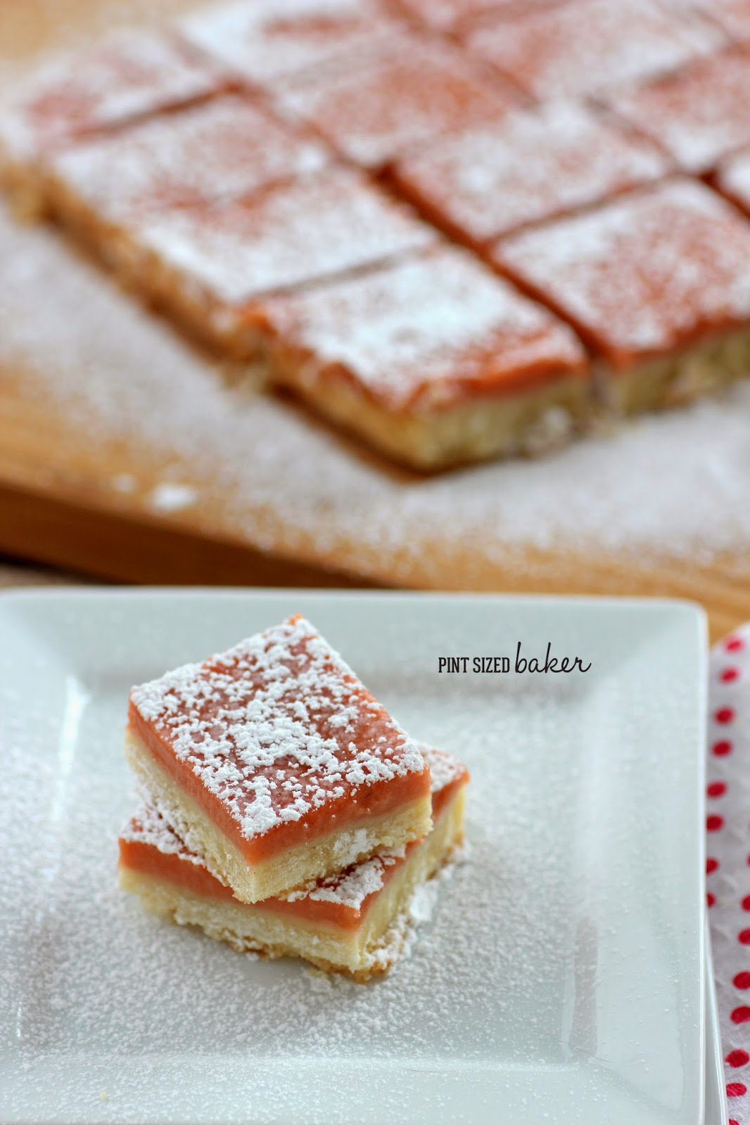 These easy Strawberry Shortbread Bars start off with a homemade strawberry rhubarb curd and end with a YUM! They are a great spring time treat!
