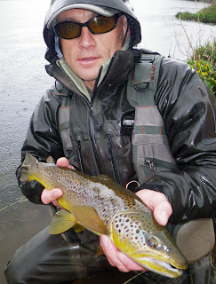 Yours truly with 2lb 6oz trout in the rain