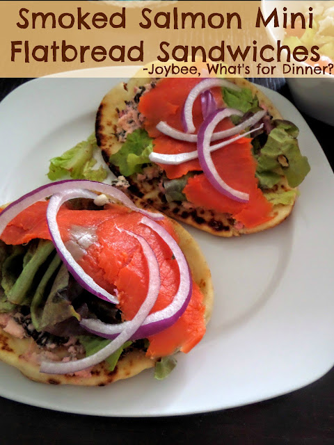 Smoked Salmon Mini Flatbread Sandwiches:  Smoked salmon atop a warm feta spread with lettuce and red onions on miniature naan bread.