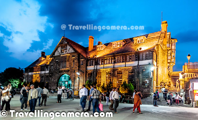 While coming back from Kinnaur, I spent two days in Shimla. While roaming on the Mall Road, we happen to visit a Cafe called 'Wake & Bake' and really loved being there during evening. This Photo Journey shares some of the moments I spent at Wake & Bake, Shimla. So here is the first view you get from the Cafe Windows. Wake & Bake Cafe is on 2nd floor of the building just in front of Shimla Town Hall on Mall Road, Shimla. It has decent place to sit on 2nd floor as well as open air terrace with a great view of the deep valley on other side.Here is the view we get from open air terrace of Wake & Bake Cafe. This view is something that you may get from other restaurants or cafes as well, but the one towards Mall road is special for me. Above view showsn two huge huge buildings - High Court of Himachal Pradesh and Holiday Home Hotel by HPTDC. Colorful view during evening was really amazing. Cafe has some vibrant colors with colorful lighting on Town Hall Building on the front & the blue sky in the background. Here is an amazing art-work on the walls of Wake & Bake Cafe. During daytime, this wall looks normal (but of-course, interesting artwork ) but in evenings all these colors pop-out to give a 3D view. It's really awesome and shiny colors make this art perfect. We also got to know the view of artist who created this wonderful piece of art on walls on Wake & Bake cafe on Mall Road, Shimla. Closer look at the wall. I loved this portion of the wall. This was looking awesome from distance. Because of good number of people at cafe, I couldn't click it from right place. Never mind, will try to get better shot next time :)I am sure that above photograph will give you a perspective about the place. This is clicked from main counter of the Cafe. As we enter into the cafe, this is first view we get. An open window facing Shimla Town Hall building and wonderful artwork on the right wall. I have nothing to share about eatable at Wake & Bake, as I don't remember what I had there. I w