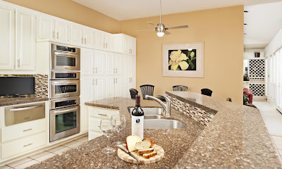 exclusive black and white rectangle tiles ties up the white and creamy wall painting for this classy kitchen design