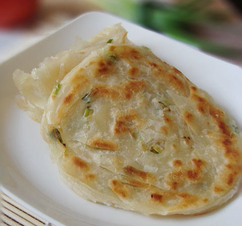 green onion pancake is a kind of pancake made of green onion and white ...