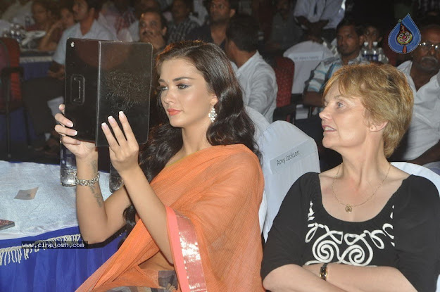 Amy Jackson in Orange Transparent Saree at event