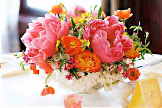 Wedding Flowers Mix in some different hues of corals oranges and pinks
