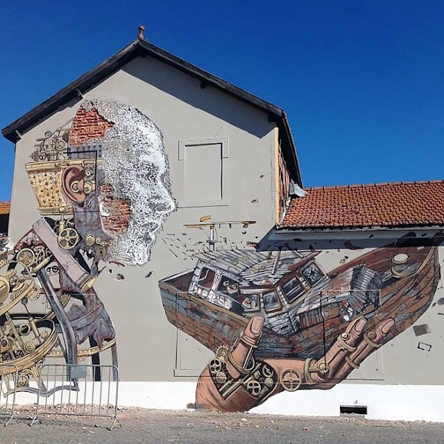 Street Art Collaboration By Vhils and Pixel Pancho On The Streets Of Lisbon, Portugal. 1