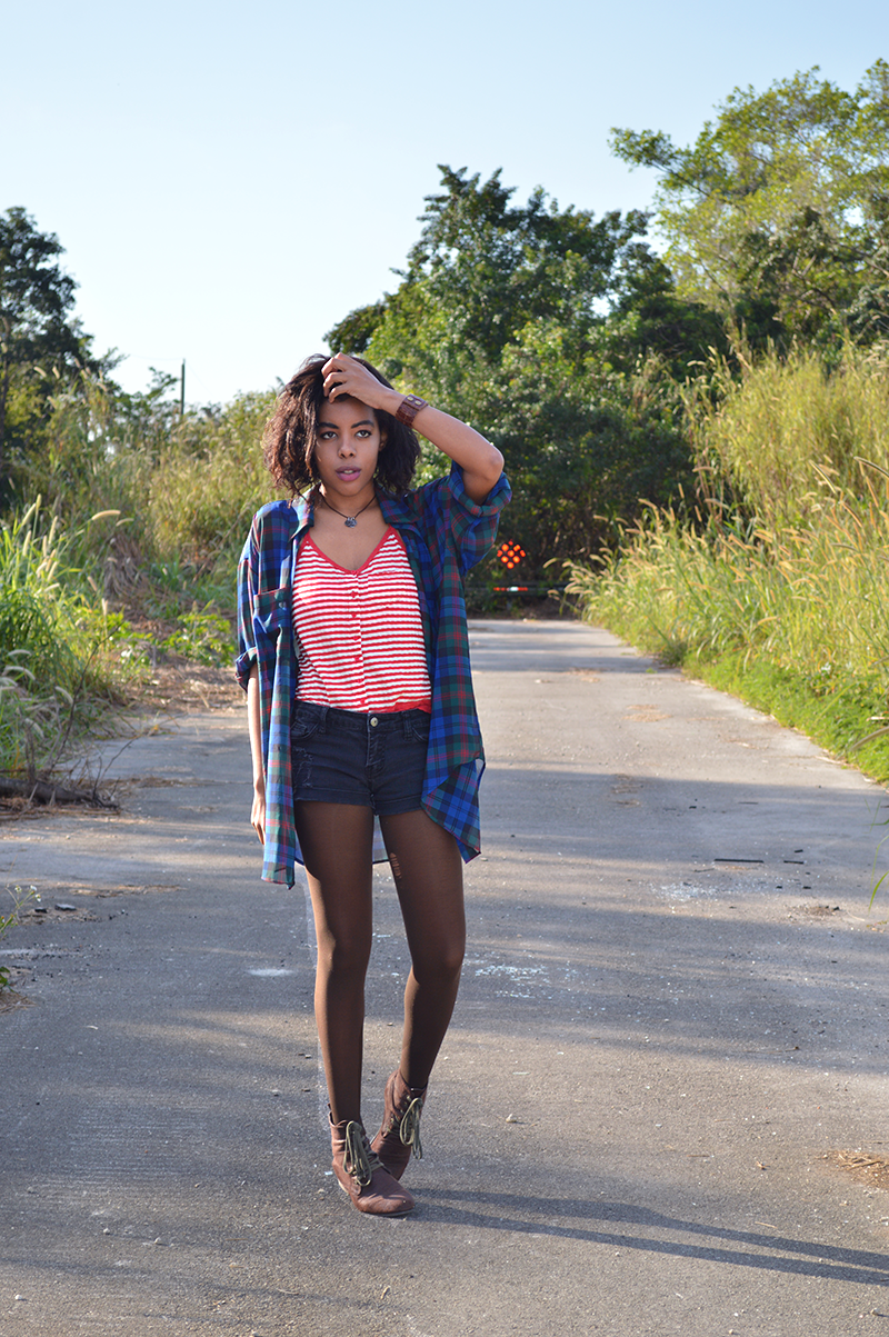 Fashion Blogger Anais Alexandre of Down to Stars in a vintage plaid oversized shirt with a Cooperative red striped tank and Forever 21 shorts and boots