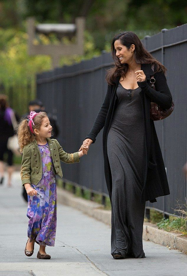 Still standing on the teamwork! The beauty lady from Hindustan enjoyed her free time with her little cute daughter as she showcased another part of her beauty by walking in a grey long dress at her apartment in New York city on Wednesday, October 29, 2014.