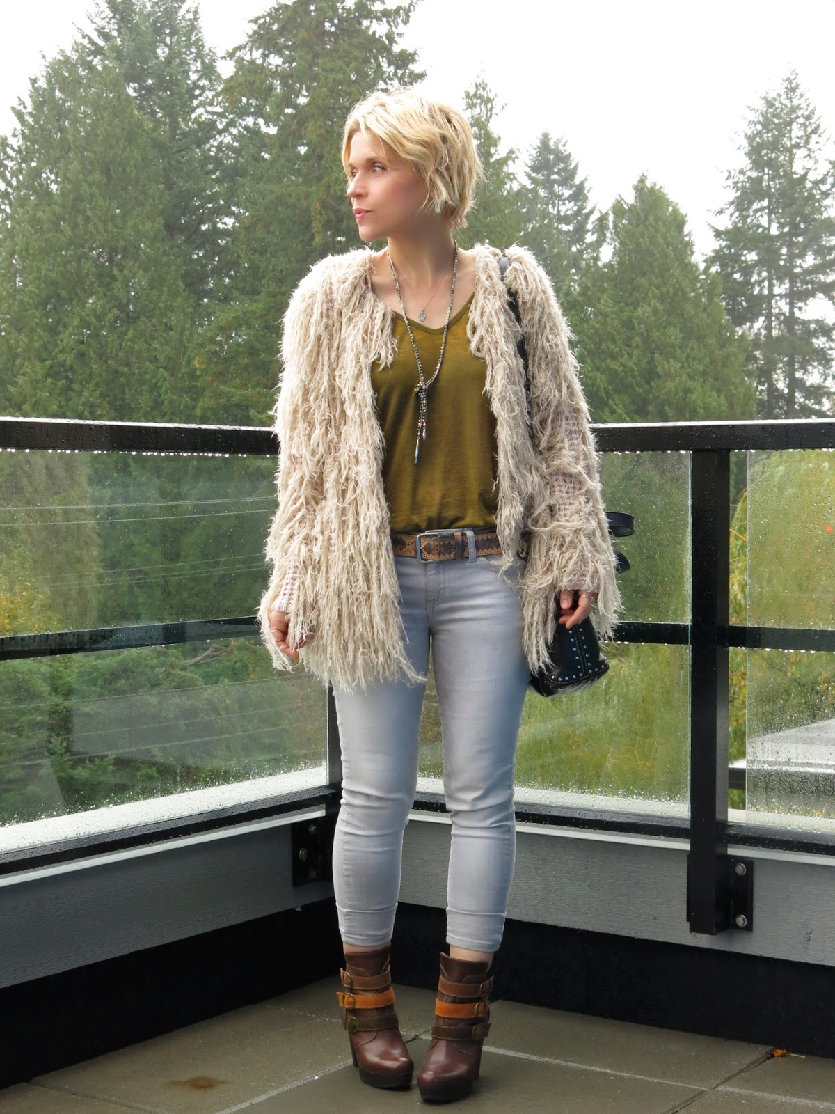 styling a Free People fringy cardigan with skinny jeans and strap-embellished ankle boots