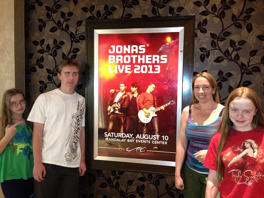 Posing with Jonas Brothers poster in Las Vegas