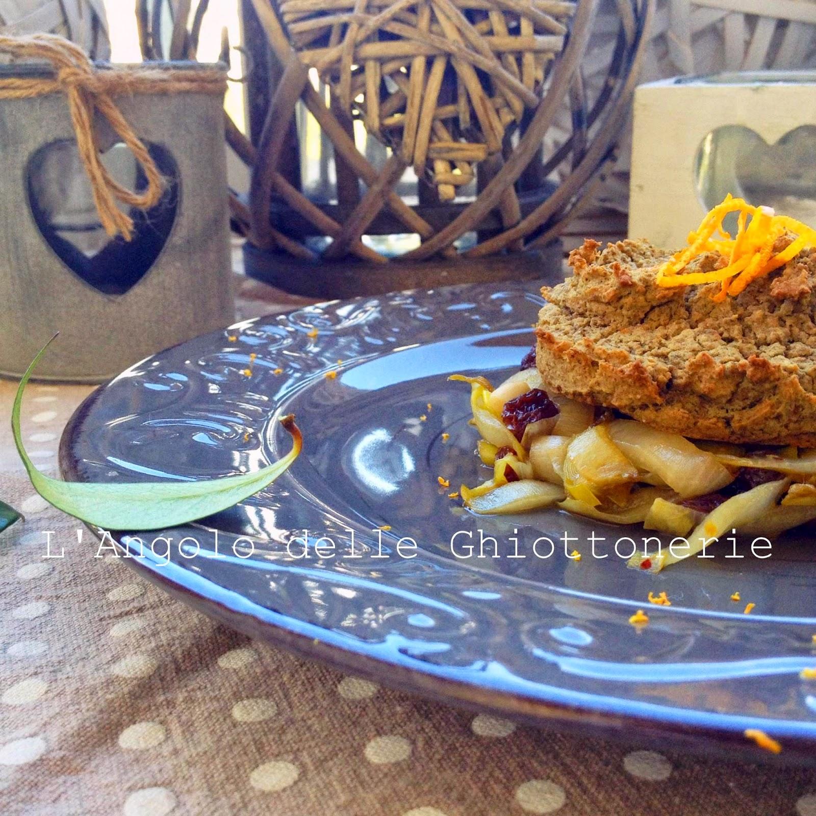sformatino senapato di lenticchie di castelluccio su letto di indivia belga caramellata, porro e scorza d'arancia