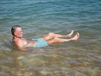 Freestyle World Traveler in 'seated float' position due to high salinity in Dead Sea, Israel
