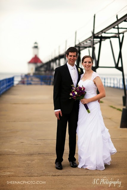 Bride and groom on Saint Joseph pier tiscornia beach photographer