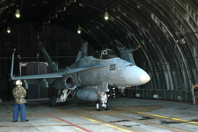 F/A-18 Hornet gets ready to taxi from fortied bunker.
