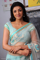 kajal agarwal hot navel show in transparent saree